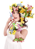 Girl with butterfly and flower on head. Royalty Free Stock Images