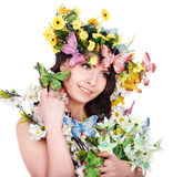 Girl with butterfly and flower on head. Royalty Free Stock Photography