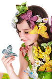 Girl with butterfly and flower. Spring hair. Stock Photo