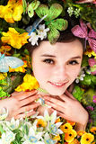 Girl with butterfly  on green grass. Royalty Free Stock Photography