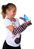 Girl With Butterfly in Hands Stock Images