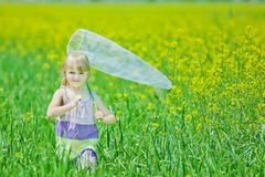 Girl with butterfly net having fun Royalty Free Stock Photos