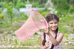 Girl with butterfly net having fun on summer Stock Photography