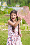 Girl with butterfly net having fun on summer Royalty Free Stock Photo