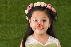 Girl with butterfly on nose Stock Image