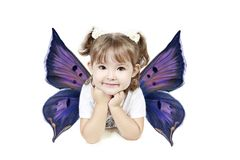 Girl with butterfly wings. Cute preschool girl with colorful, butterfly wings, isolated on white background stock photography