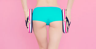 Girl buttocks in sports swimsuit Royalty Free Stock Photography
