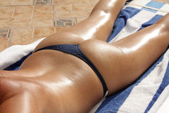 Girl buttocks under the sun Stock Photography