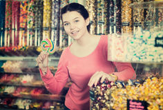 Girl buying candies at shop Stock Image