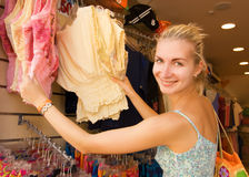 Girl buying clothes Royalty Free Stock Photography