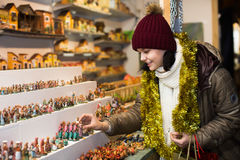 Girl  buying figures for creating Christmas Royalty Free Stock Photo