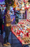Girl buying gifts at Christmas market in Bucharest Stock Images