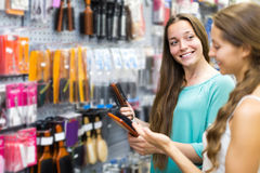 Girl buying hairbrush in shopping mall Stock Photography