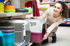 Girl buying kennel for pet in shop Royalty Free Stock Photography