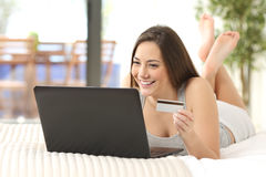 Girl buying on line in her room Royalty Free Stock Photography