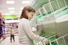 Girl buying notebooks for school. Schoolgirl choosing office supplies in shop stock image