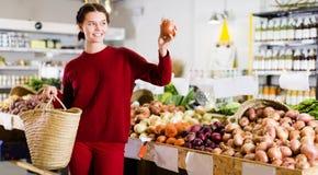 Girl  buying onion Stock Photos