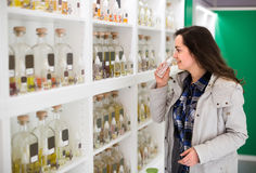 Girl buying perfume in fragrance boutique Royalty Free Stock Image