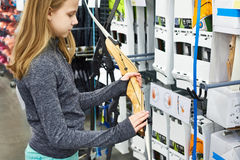 Girl buys a bow in sport store Royalty Free Stock Photos