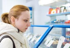 Girl buys a candy store Royalty Free Stock Photos