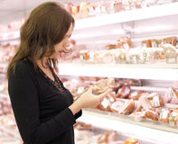 Girl buys meat in a super market Stock Image