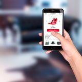 A girl buys red shoes in an online store. Mobile Shopping stock photos