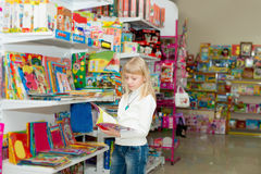 Girl buys school accessories. Royalty Free Stock Images