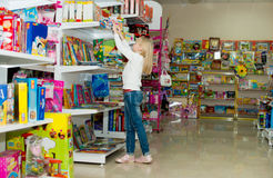 Girl buys school accessories. Royalty Free Stock Image
