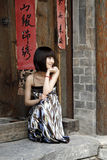 Girl By The Ancient Door Stock Photo