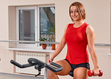 Girl bycicle cycling in gym Royalty Free Stock Photography