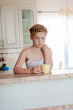 girl c cup of tea in the kitchen Royalty Free Stock Images