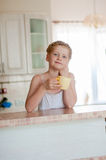 Girl c cup of tea in the kitchen Stock Photos