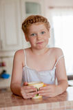 Girl c cup of tea in the kitchen Royalty Free Stock Photo