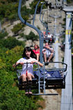 Girl in cable car over a mountain Royalty Free Stock Photo