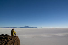 Girl at cactus island. At the Uyuni salt flates, Bolivia Royalty Free Stock Image