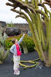 Girl in cactus park Royalty Free Stock Photos