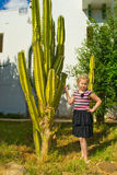 Girl with a cactus Royalty Free Stock Image