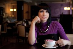 Girl in cafe Stock Photography