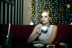 The girl in the cafe Royalty Free Stock Image