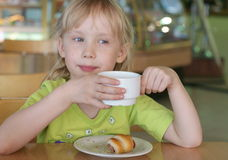 Girl in a cafe Royalty Free Stock Image