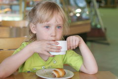 Girl in a cafe Stock Images