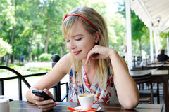 Girl in the cafe Royalty Free Stock Image