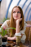 Girl in cafe. Beauty young fashion girl in cafe royalty free stock photography