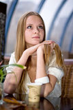 Girl in cafe. Beauty young fashion girl in cafe royalty free stock images