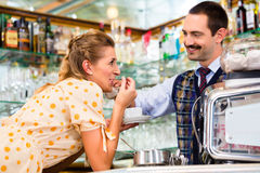 Girl in cafe or coffee bar flirting with barista Stock Photography