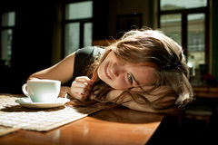 Girl in a cafe with a cup of coffee Royalty Free Stock Image