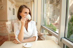 The girl in cafe drinks coffee Stock Photo