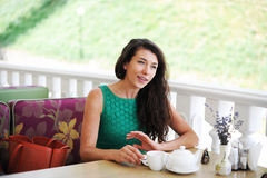 The girl in cafe. The girl has early in the morning breakfast in cafe Royalty Free Stock Images