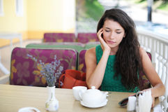 The girl in cafe. The girl has early in the morning breakfast in cafe Royalty Free Stock Photos