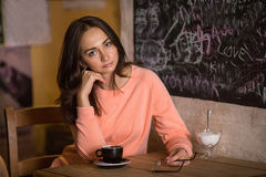 Girl in a cafe with a hot chocolate. Stock Image